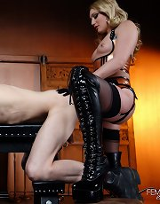 Mistress AJ Applegate makes Her slave Her bitch with Her strap-on cock.