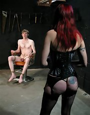 johnny rocket is treated like a human ashtray by Mz. Berlin. She thoroughly enjoys seeing him writhe in pain as the clothespins are applied all over his chest and dick. The wormboy stares at her huge tits before being placed in some really tight and mean